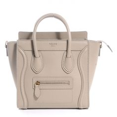 This is an authentic CELINE Smooth Leather Nano Luggage Bag in Ecru.   This stylish small travel tote is crafted of beige leather.