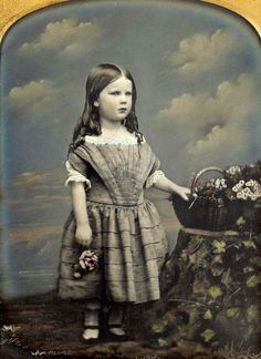 Hand-colored daguerreotype portrait of an unidentified girl posing with flowers, 1856. By William Edward Kilburn.