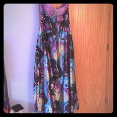 Prom Dress Floral pattern, long, silky material, open back, strapless, beaded front, lavender top part and then turn into a multicolor bottom. Dresses Prom