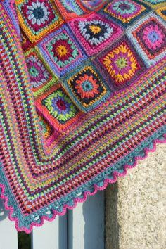 Beautiful crochet blanket...love the moss stitch border.