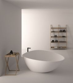 simple modern white bath shelving tray table sculptural tub hallway light