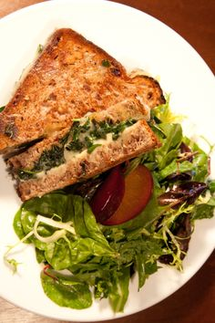 delux grilled cheese sandwiches:  spinach, thinly sliced onion, swiss and muenster cheese.  Delicious for a vegetarian meal with tomato soup