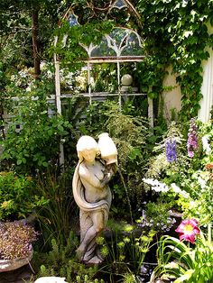 salvage garden ~ Love this old recycled window for climbing flowers instead of an arbor or trellis Garden Fountains, Garden Statues, Garden Windows, My Secret Garden, Secret Gardens, Garden Inspiration, Garden Ideas, Parcs, Garden Ornaments