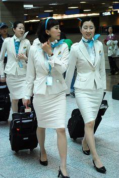 Korean Air Flight Attendants uniforms designed by Gianfranco Ferre. Love them!!!