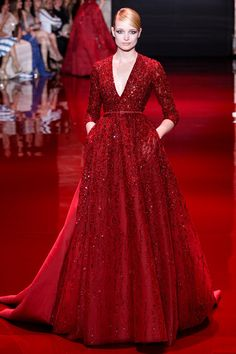 Red beaded 3/4 sleeves gown with deep v-neck. Elie Saab Fall 2013 Couture Collection Slideshow on Style.com
