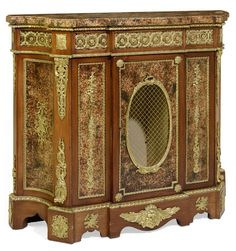 A FRENCH ORMOLU MOUNTED AND MAHOGANY VENEERED CABINET : Lot 303