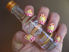 Smirnoff Vodka-inspired nail art using OPI My Boyfriend Scales Walls, Zoya Pippa and Jancyn, and Essie Off The Shoulder.  Technique: Coat nails in white nail polish; use a large dotting tool to make a few dots in pink at the tip.  Fill in with small dots using a smaller dotting tool.  Repeat with yellow and orange polishes.
