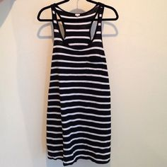 J Crew Racerback Dress Black and white stripped racerback dress. It has a little pocket on the chest . It's a 100% cotton . From the top of the straps it measures 34 inches long. Worn twice , great condition!! J. Crew Dresses