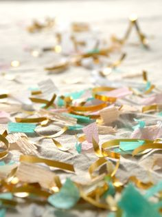 Adorable confetti made of streamers and gold ribbon.