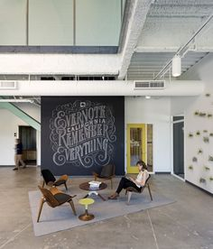 Completed in 2012 in Redwood City, United States. Images by Jasper Sanidad. At Evernote in Redwood City, California, the strict budget and swift pace of construction helped determine the direction of the. Evernote, Office Workspace, Office Walls, Office Spaces, Small Office, City Office, Home Office, Commercial Design, Commercial Interiors