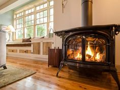 A+cast-iron,+direct-vent+gas+stove+replaces+the+home's+circa-1980s+brick+fireplace.+Fan+and+flame+levels+are+controllable+via+remote,+and+operable+glass+doors+lend+ambiance.