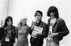 Joan Jett of the Runaways, Debbie Harry of Blondie, David Johansen of the New York Dolls, and Joey Ramone of the Ramones pose for a picture together.