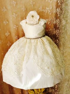 Beautiful silk and bridal lace flower girl dress. This is a very unique dress Hand made in our studio. I designed this christening dress for a client that wanted something beautiful and unique. This i