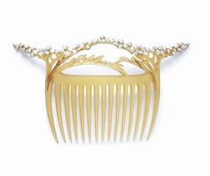 AN ART NOUVEAU HORN AND SEED PEARL HAIRCOMB, BY PAUL LIENARD  Designed as carved horn bowed stems, enhanced by seed pearl blossoms, circa 1900, in a Paul Liénard leather fitted case