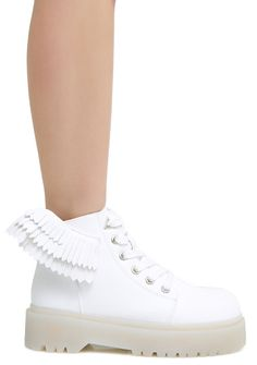 Y.R.U. Slayr Angyl Boots if you believe you can fly. These sikk white vegan leather boots have 3D wings on the sides, lace-up front, and cleated platforms soles that will have you feelin' fly af.