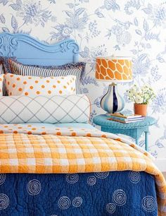 The shades of blue and orange in this room are exact complements of each other, found on exact opposite sides of the color wheel. The look literally is complementing and very pleasing to the eye.
