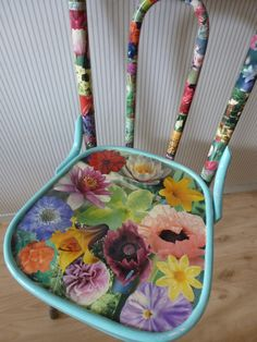 don't throw away  old chairs but pimp them with flowers cut out of magazine. I used glue for wallpaper and finished it with lacquer used for boats