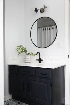 A teenage bathroom remodel featuring our navy nickel Cap Double Globe Sconce 6 installed as vanity lighting above a modern circular mirror in a bathroom featuring black, navy, and white decor. Space by Brooke Roelofs of Coastal Dream Design. Bathroom Styling, Bathroom Storage, Bathroom Interior Design, Bathroom Organization, Bathroom Mirrors, Master Bathrooms, Black Cabinets Bathroom, Dyi Bathroom, Marble Bathrooms
