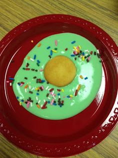 """yummy treat for Dr. Seuss' book """"Green Eggs and Ham."""" vanilla pudding, colored green, add a vanilla wafer to the middle as the """"yoke"""" of the egg. To top it off, you can add some sprinkles for fun."""