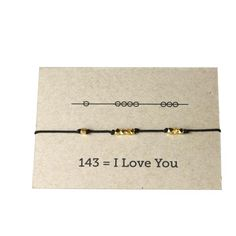 "This isn't just a super cute layering bracelet, it also communicates ""I love you"" in code. Bracelets make a great gift for sisters, best friends, mothers to daughters, you name it. Such a fun secret way to remind someone they are special to you! They also look great layered up! Nylon cord knotted between gold plated bronze nugget beads. in 143 arrangement to say ""I Love You"". Adjustable length through sliding knot. You will receive one bracelet in Black. More Images Coming Soon! (Nylon…"