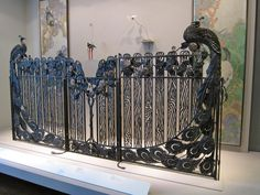 Peacock gate dedicated to birds by wrought iron master Jean Perrot