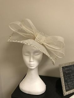 02542db837725 Handmade large fascinator with cream sinamay and pearl and diamante detail  on the rim and in