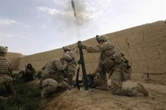 The 82nd in Afghanistan -- U.S. Army soldiers from 4-73 Cavalry Regiment, 82nd Airborne Division, fire a mortar during a firefight with Taliban while on a mission in Zhary district of Kandahar province, April 18, 2012.   REUTERS/Baz Ratner