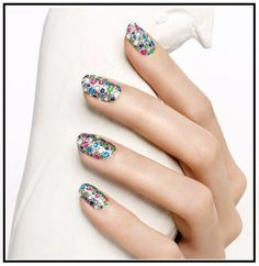 Super cute summer style nails using small colored rhinestones.