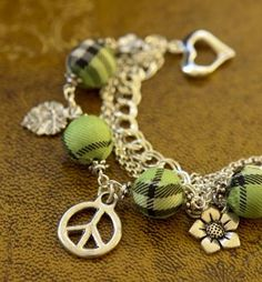 Peace, Leaf, Flowers Charms and Green Tartan Beads Bracelet by Maffa for $31.99