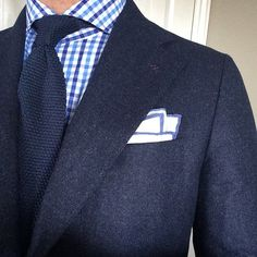 Navy jacket, white shirt with blue tattersall, navy tie