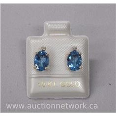 Ladies 10kt Gold Oval Blue Topaz and Diamond Earrings (3.00cts) - Auction Network
