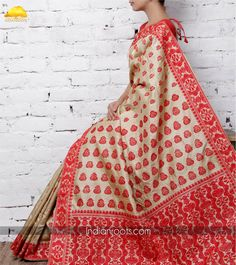 Beige muga silk saree featuring red kalash motifs all over by Artisans-of-assam on Indianroots.com