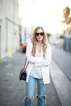 Nothing like a blazer to dress up ragged jeans.