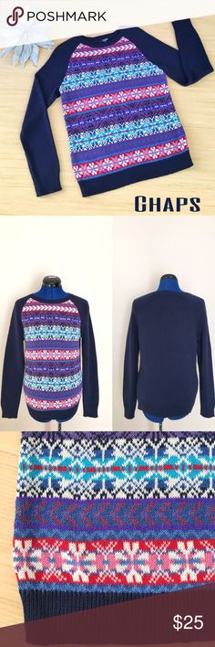 Chaps Sweater Size Medium NWT Transition from winter to spring in this beautiful navy blue sweater by Chaps! The snowflake design on the front will have you looking cute for the winter but the pink, red, and purple colors hint at the warmer spring weather that is to come. The sweater is made of 62% cotton and 38% polyester making it not itchy at all. When measured laying flat, from armpit to armpit it is 18 inches across and shoulder to hem it is 23 inches long. This sweater is a size Medium…