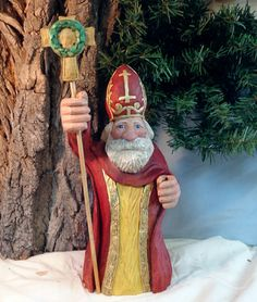 Hand carved wood Saint Nicholas in crimson by WeAreOutofOurGourds, $125.00