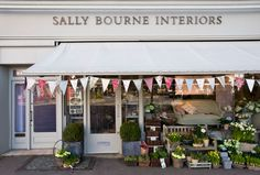Love this store front - flags + cute little plants