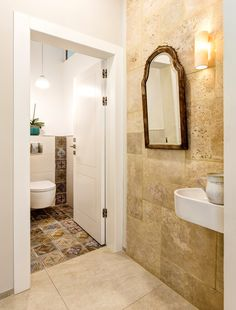 Bringing a little edge to your guest toilet with pattern tiles against the clean white walls