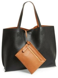 5f58e5985208 Supersoft faux leather flips inside-out for a reversible tote while a  matching wristlet