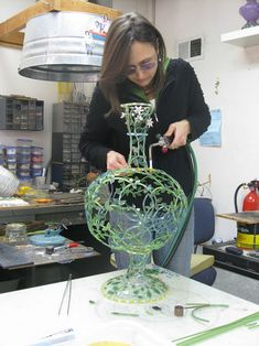 How it all works — Kari Russell-Pool, in the process of assembling one of her vases.