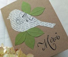 Combo of printed book paper and solid color / pressed leaves on simple brown is interesting and elegant