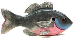 "George Aho decoys are increasingly collectible as they gain age and are  appreciated for their unique folk art qualities. This example represents a sunfish  and measures 7"" long. It has carved gills and a cut out mouth.(90)"
