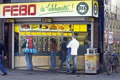 The Dutch fastfood chain Febo.  You buy 'patat' (Dutch fries), hamburgers and drinks at the counter.  Other Dutch snacks such as 'kroketten', 'nasiballen' and 'frikandellen' are bought from the automats.