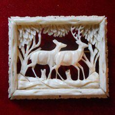 ivory carved brooch