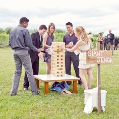 An oversized Jenga game is a cinch to create —all you need to do is take a trip to the hardware store for some lumber and have each cut to the same length (a traditional Jenga set uses 54 blocks).Photo Credit: Young Hearts Photography