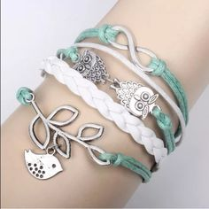 Blue owl bird leaf infinity bracelet white leather Infinity bracelet as pictured colors May look different on bracelet than picture shows. Sometimes it is hard to get an accurate picture. Bundle with another bracelet 2/$12. Jewelry Bracelets