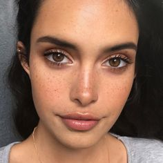 Natural makeup and freckles