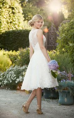 Embroidered Knee-Length Wedding Gown is made from gorgeous lace on tulle, and features a pretty lace illusion neckline and back.