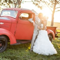 A beautiful country inspired wedding featuring an old restored barn, a vintage red truck, and lots of cowboy boots.
