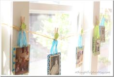 We mounted them on tiny gift bags {dollar section of Target} and hung them from raffia behind the dessert table.