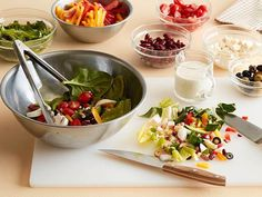 Ree's New York-Style Chopped Salad is made to feed a large group. Lay out the greens and all the fixings in small dishes and then have everyone build their own salad by throwing what they want into their own bowl.